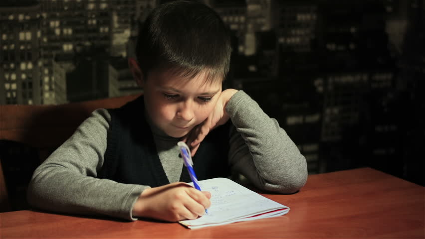 Sleepy schoolboy tries to do his homework late at night | Shutterstock HD Video #26129417