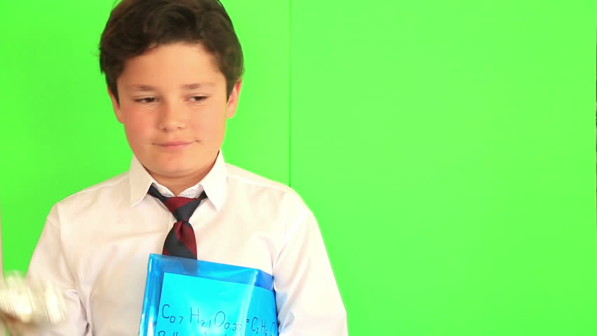 Elementary school boy receiving a trophy on chroma key green screen background | Shutterstock HD Video #26139659