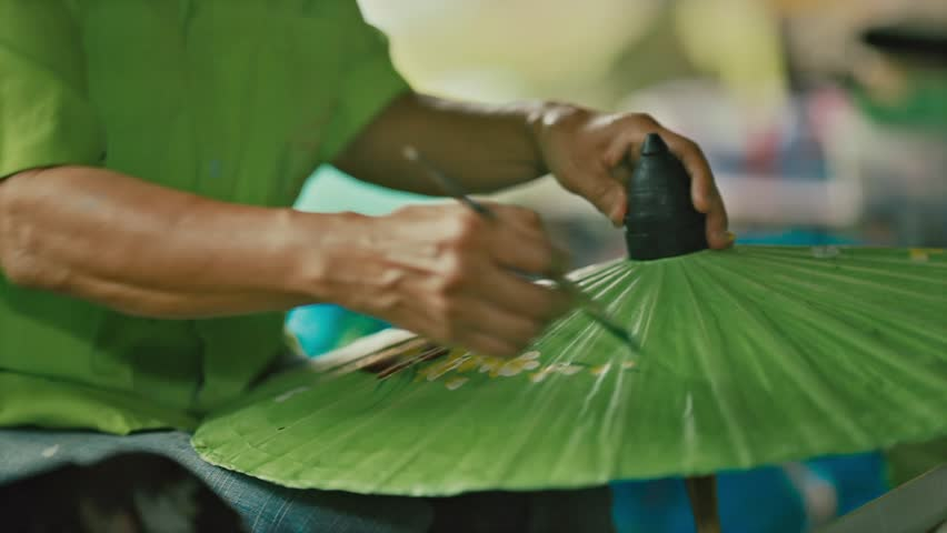 How to make the process umbrella made of paper / fabric. Arts and crafts of the village Bo Sang, Chiang Mai Thailand. | Shutterstock HD Video #26196098