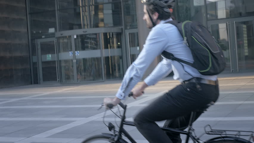 Young employee traveling to work by bicycle in the city. Handsome elegant cyclist commuting. Living an active life. | Shutterstock HD Video #26214899