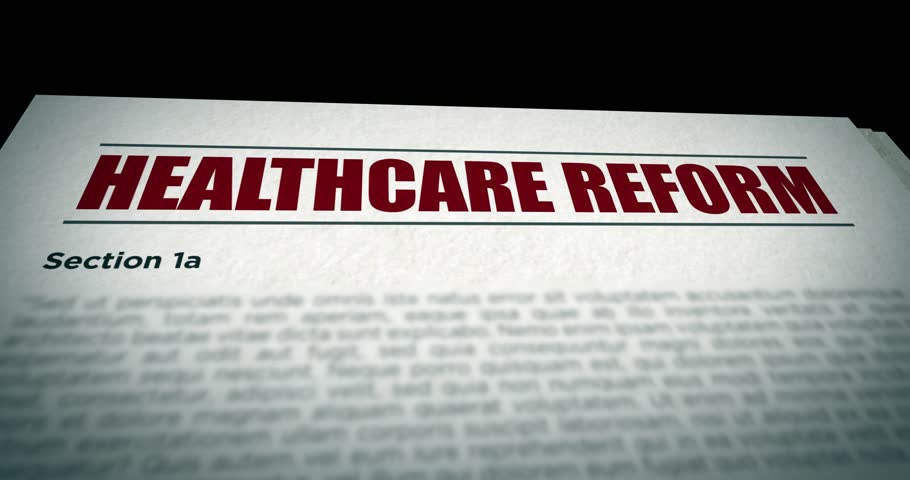 Camera pans over Healthcare Reform government Bill document | Shutterstock HD Video #26218904