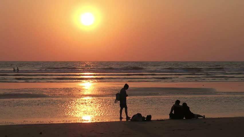Holidaymakers are walking along the ocean at sunset in India | Shutterstock HD Video #26219237