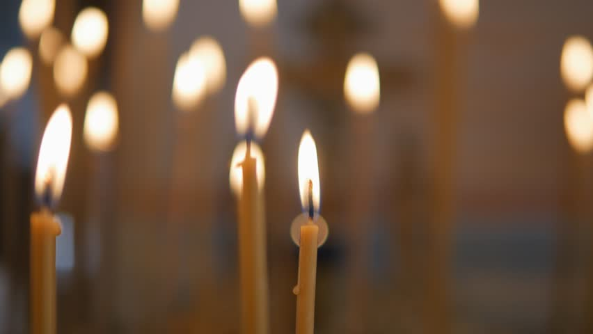 Burning candles on the altar | Shutterstock HD Video #26219768