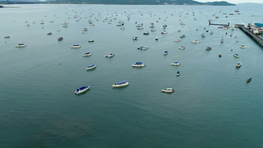 Top view speed boat parked in the sea at Chalong bay, Phuket province, Thailand. Aerial view from flying drone | Shutterstock HD Video #26220452
