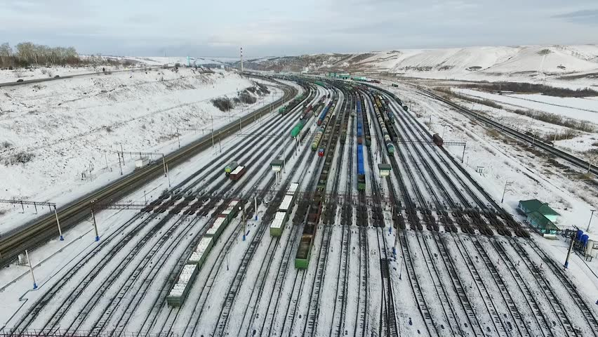 The railway station sorting of cars, Russia winter in Siberia, shooting from air | Shutterstock HD Video #26220776