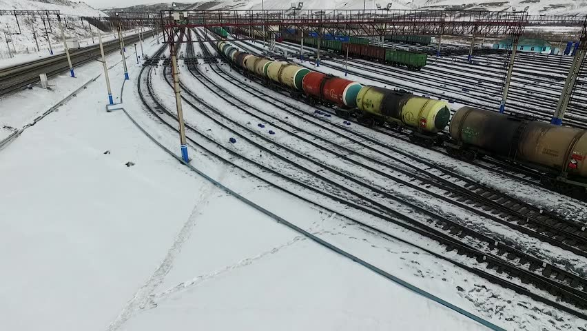 The railway station sorting of cars, Russia winter in Siberia, shooting from air | Shutterstock HD Video #26220794