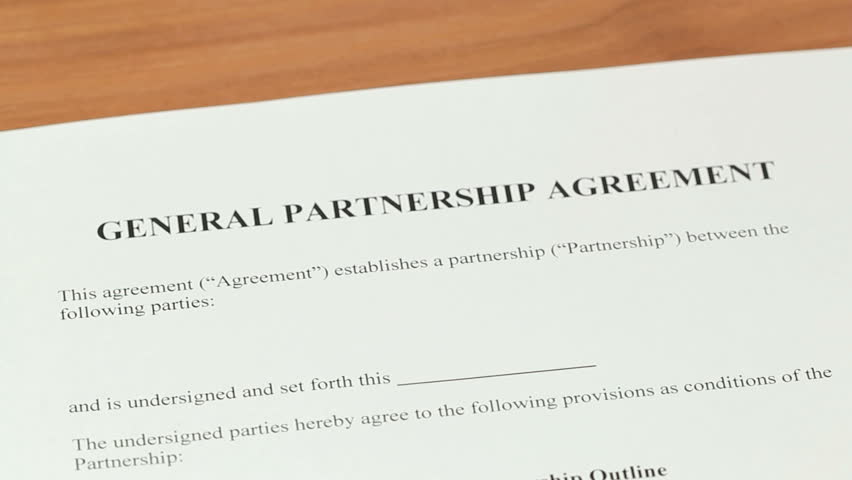 Partnership Agreement - Over the shoulder shot of a general partnership  contract being signed by both parties - HD stock video clip