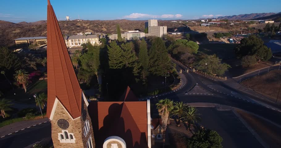 Aerial drone video with view of old historical fort in city center of Windhoek, other old buildings and church in town in central highland Khomas Hochland of Namibia, southern Africa | Shutterstock HD Video #26221442