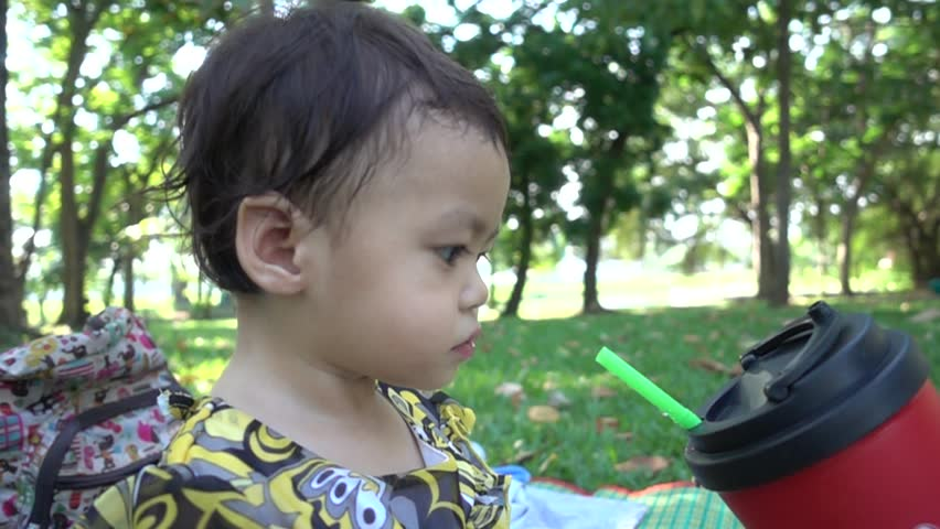 Asian baby girl eating water with tube, Slow motion | Shutterstock HD Video #26222891