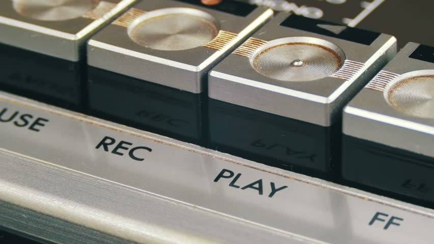 Pushing Play Button on a Vintage Tape Recorder. Close-up. Pushing a Finger Button Play. Man finger presses playback control buttons on audio cassette player. | Shutterstock HD Video #26224034