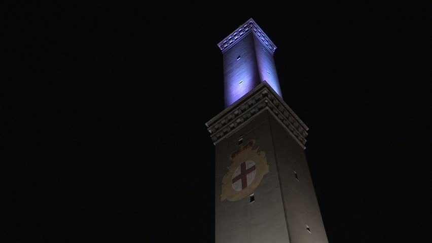 Shot of the lantern of Genoa blinking by night / The lantern of Genoa by night / GENOA, ITALY – MARCH 14  201 | Shutterstock HD Video #26224772