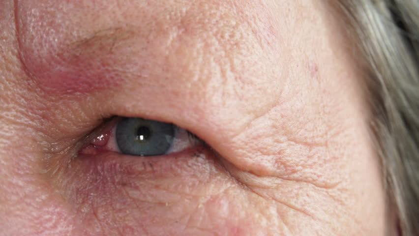 Close up of senior woman face and eye. Age, vision and old people concept 4K ProRes HQ codec | Shutterstock HD Video #26225510