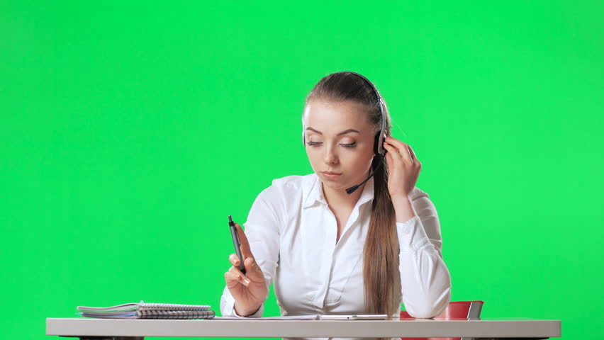 The secretary of the call center threw her legs on the table, green screen, alpha | Shutterstock HD Video #26225528