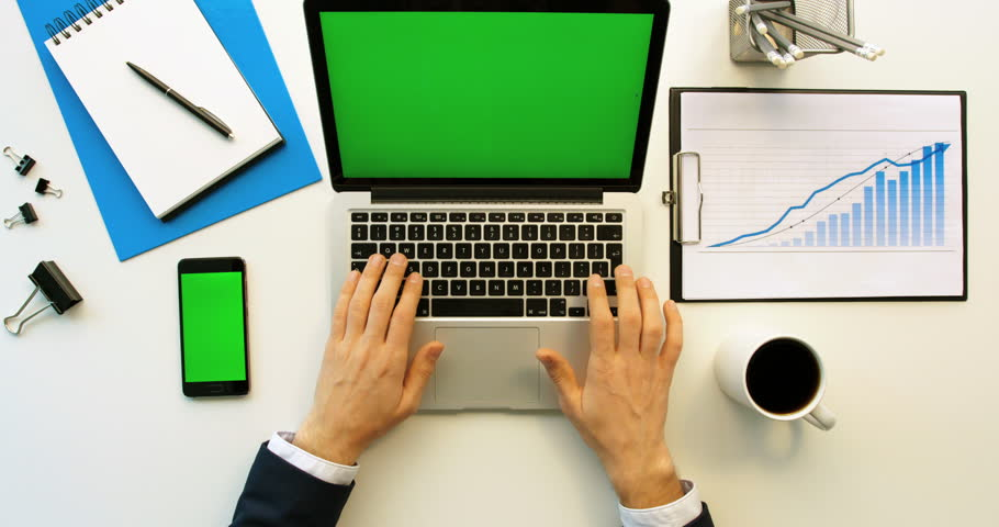 Business man working with laptop and smartphone with green screen on white office desk. Top view. Chroma key | Shutterstock HD Video #26225699