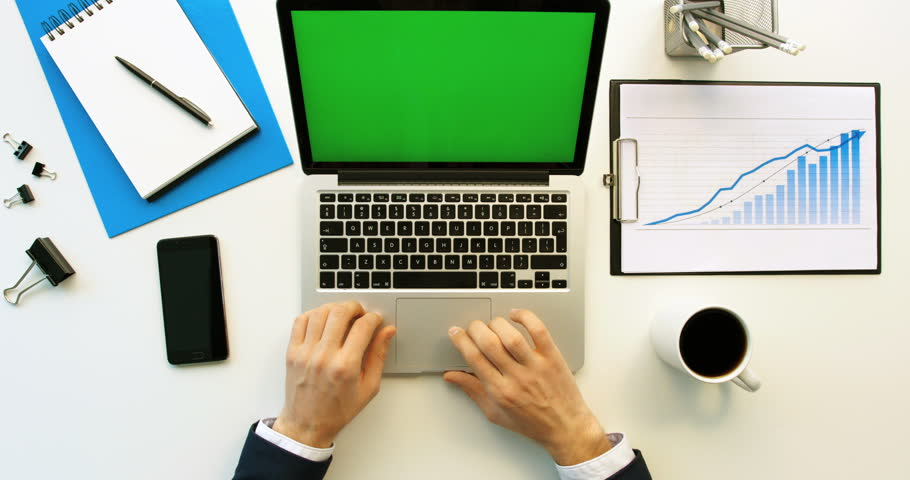 Business man working with laptop compute with green screen on white office desk. Top view. Chroma key | Shutterstock HD Video #26225717