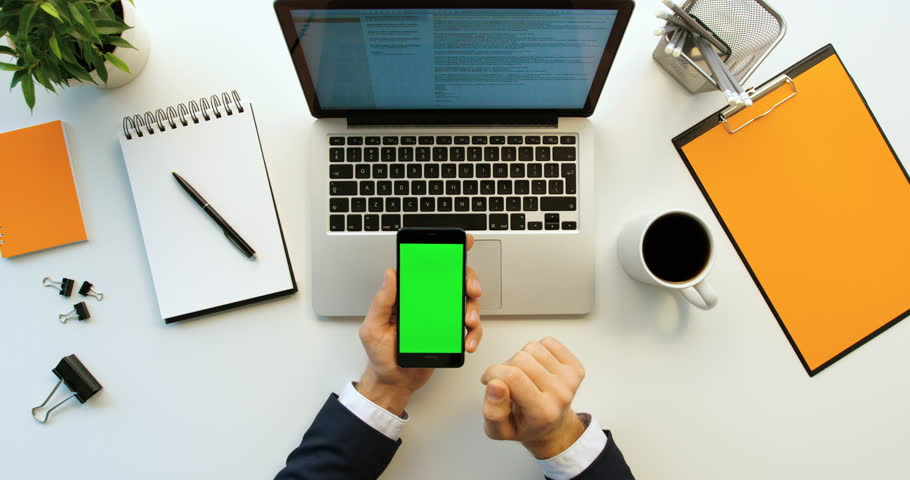 Top view business man using smart phone with green screen, scrolling pages, tapping on touch screen on office desk background. Green screen. Chroma key | Shutterstock HD Video #26225726