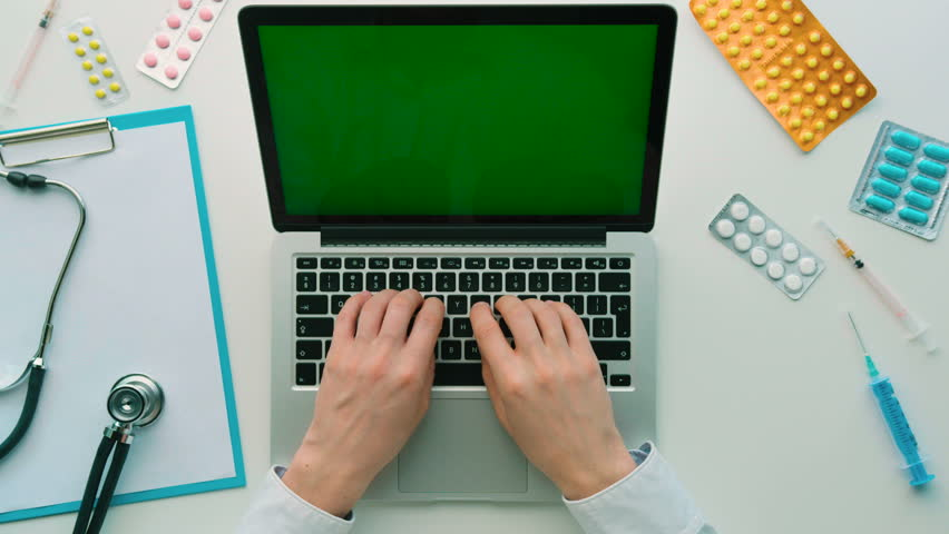 Doctor seaching something on laptop with green screen. Chroma key. Top view. White background | Shutterstock HD Video #26226185