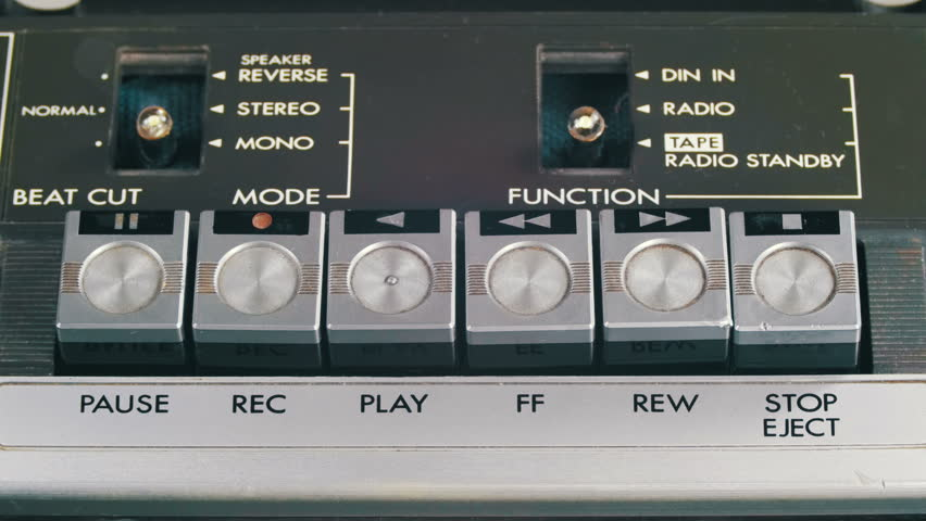 Pushing Play, Stop, Forward, Rewind, Pause and Record Control Buttons on Vintage Tape Recorder. Close-up. Man finger presses playback control buttons on audio cassette player. | Shutterstock HD Video #26227760