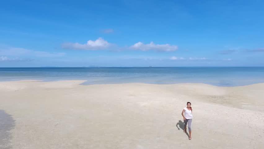 Happy Mixed Race Girl Running on Beautiful Beach. Koh Phangan, Thailand. HD Aerial Slowmotion. | Shutterstock HD Video #26227931