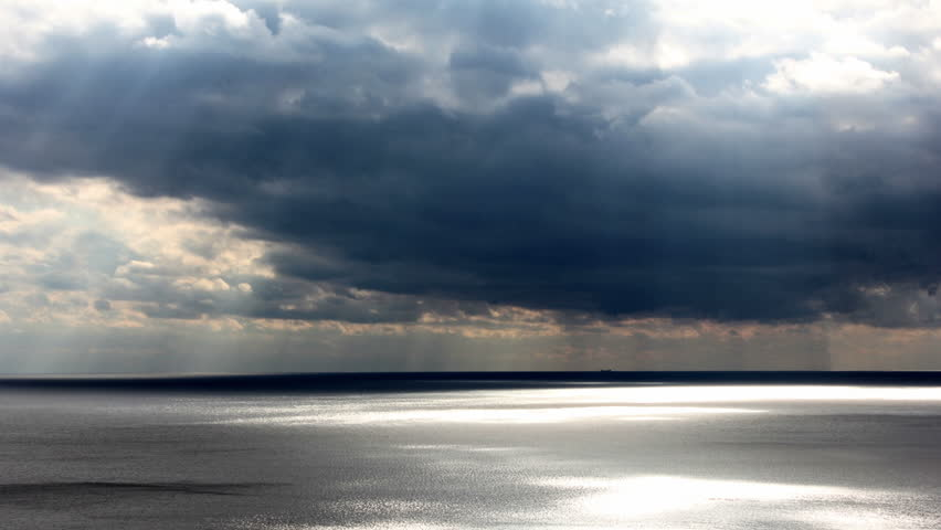 dark clouds moving over the sea - HD stock video clip