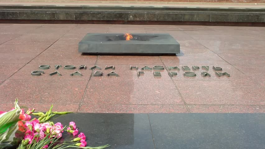 """BREST, BELARUS - AUGUST 4: The Eternal Flame at the Brest Fortress on August 4, 2012 in Brest, Belarus. The inscription reads """"Stood up to the end / Glory to the heroes."""" - HD stock video clip"""
