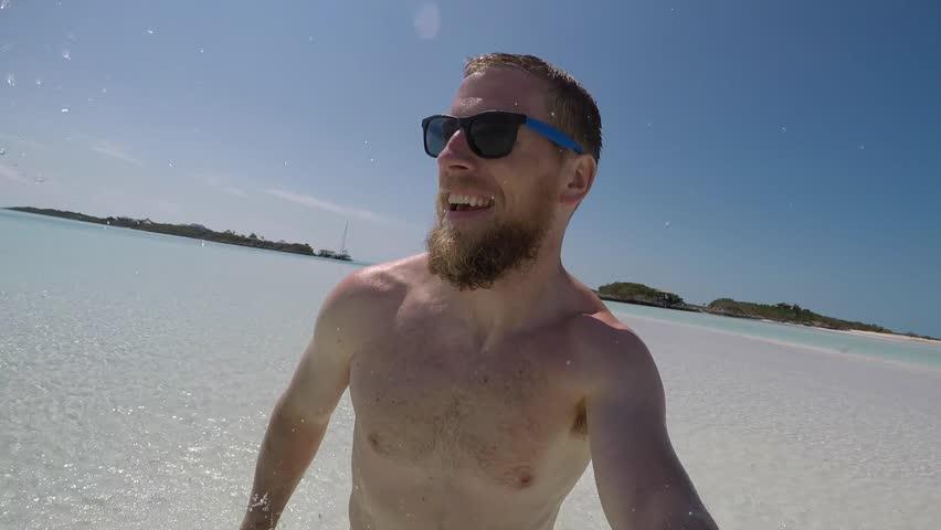 man running in the shallow ocean selfie gopro #26330324
