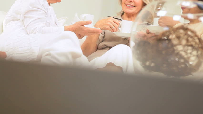 Three senior lady friends enjoying social afternoon with coffee - HD stock footage clip