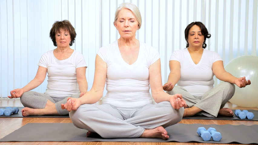 Senior ladies taking part yoga class health club - HD stock footage clip
