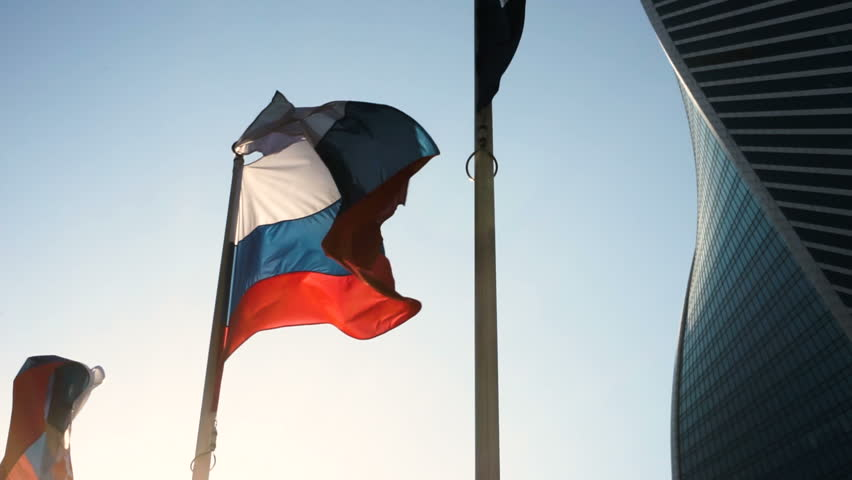 Close-up shot of flag of Russia in the wind on the background of Moscow City. HD #26426201