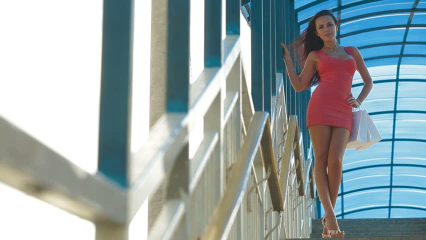 Beautiful Young Woman with Shopping Bags Posing, Sequence | Shutterstock HD Video #2651513