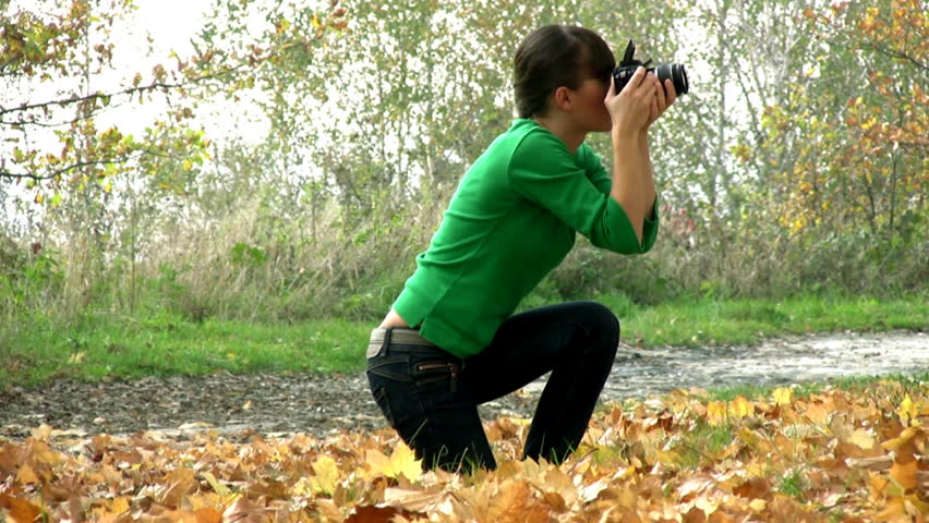 Girl taking photos with DSLR, tripod shot  - HD stock video clip