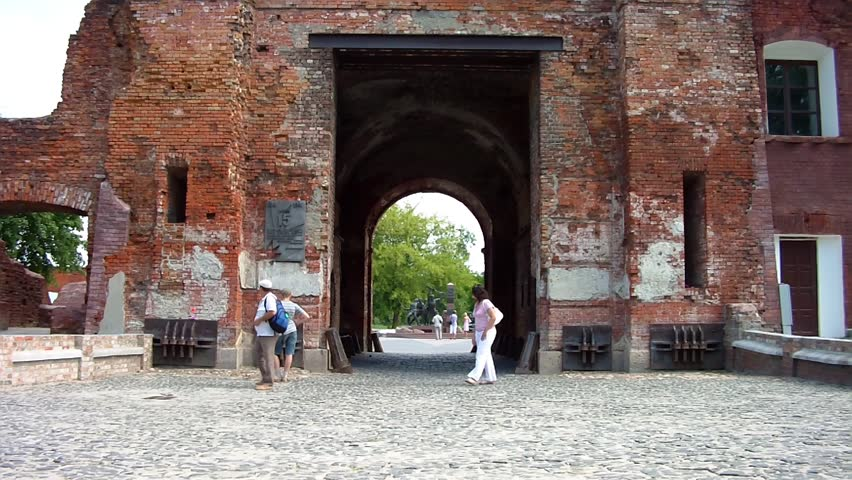 BREST, BELARUS - AUGUST 4: People walk along the Terespol gate at the Brest Fortress on August 4, 2012 in Brest, Belarus. Here began the invasion of Hitler's Germany on the USSR on June 22, 1941. - HD stock video clip