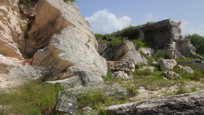 Remains of a building off the shore of Horseshoe Bay in Bermuda. - HD stock footage clip