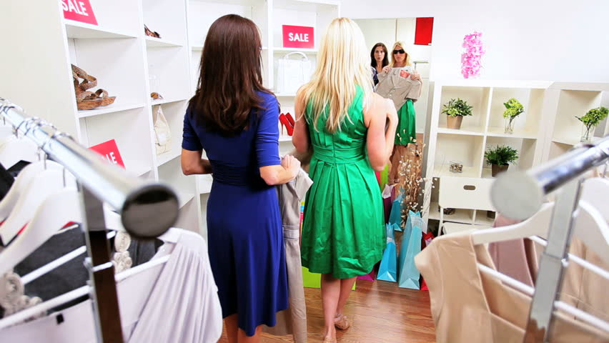 Females shopping for clothes  | Shutterstock HD Video #2669558