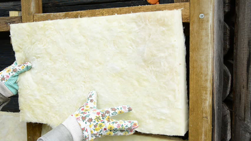 Man injecting insulation into a cavity wall stock footage for Mineral wool wall insulation