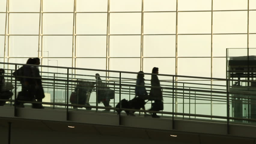 Silhouettes of Travellers in Airport - Hong Kong International Airport Terminal. | Shutterstock HD Video #2681276