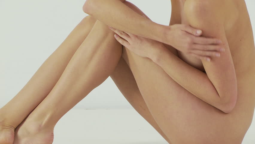 Woman sitting and rubbing legs - HD stock video clip