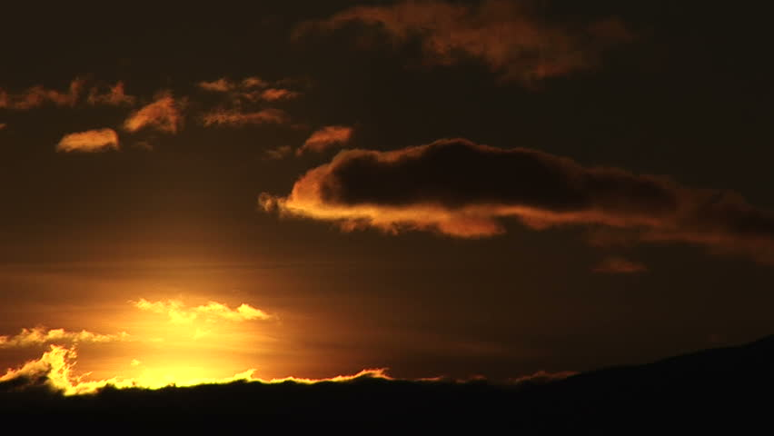 Orange sky as the sun sets in Puerto Natales, Chile - HD stock video clip