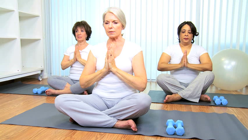 Yoga group older ladies health club class - HD stock video clip