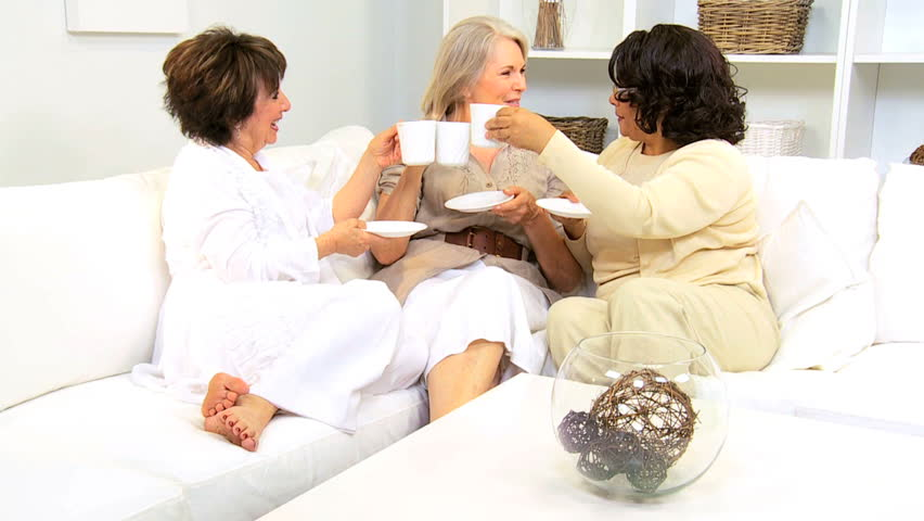 Three senior lady friends enjoying social afternoon with coffee - HD stock video clip