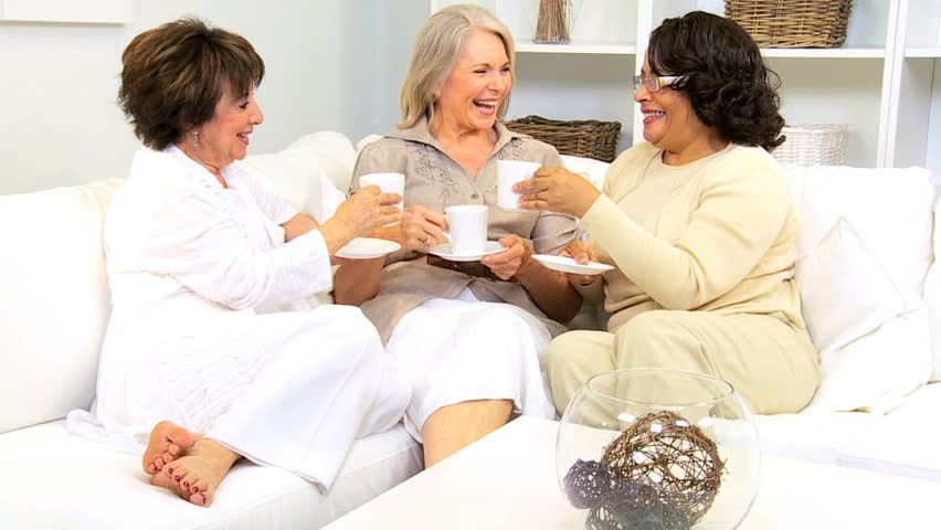 Three retired multi ethnic friends enjoying coffee morning home - HD stock footage clip