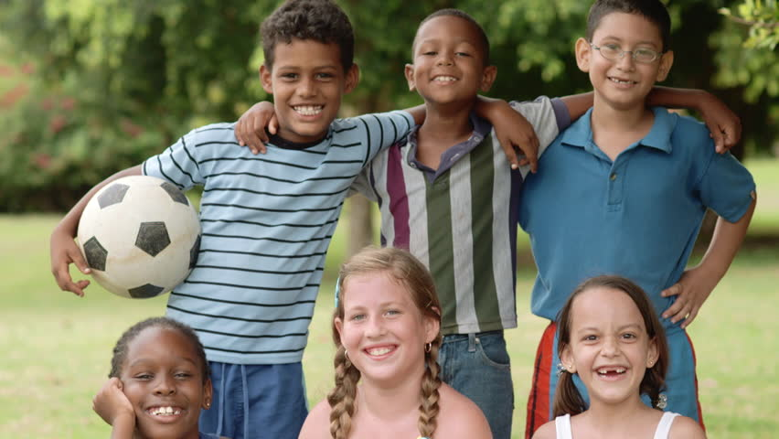 Multiethnic young people pose with soccer ball, portrait of six happy children with football looking at camera and smiling - HD stock footage clip