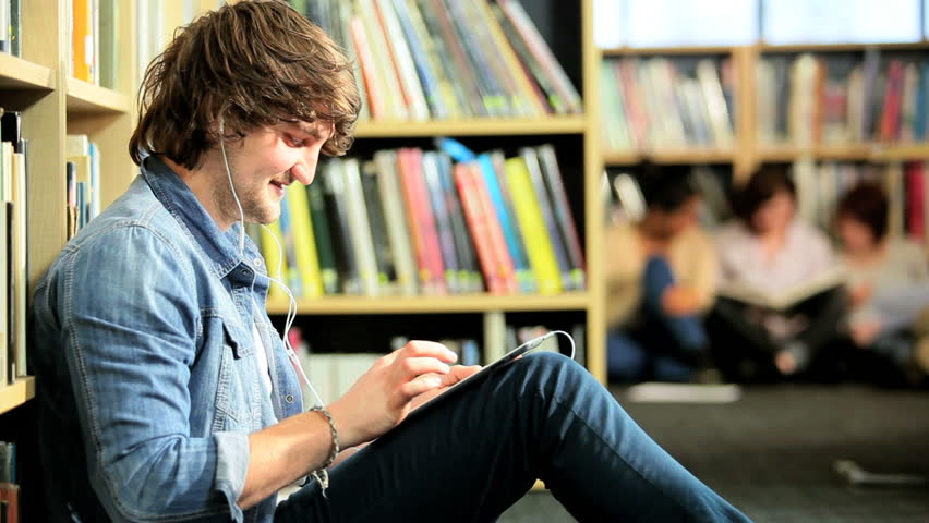 Young male Caucasian classmate using tablet and listening to IT lecture in college hub - HD stock footage clip