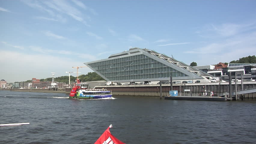 HAMBURG, GERMANY - AUGUST 01: Passing the Dockland house on the waterside. This modern landmark was built in 2005.  - HD stock footage clip