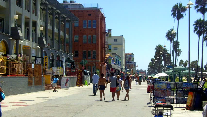 A shot looking down the Venice Beach Boardwalk with souvenir shops, historic