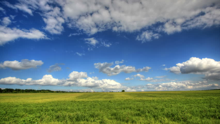4K. Timelapse clouds over the green field. FULL HD, 4096x2304.