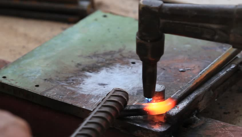 Gas heating cutting metal using torch and bending square bar, industrial construction clip. - HD stock video clip