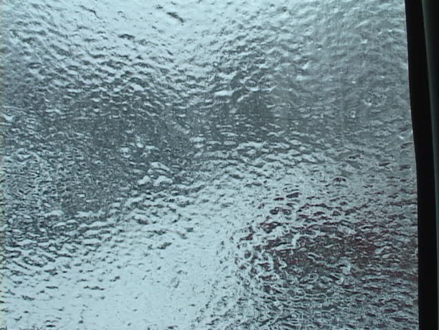 ice formed on the window stands alone when window is down - SD stock footage clip