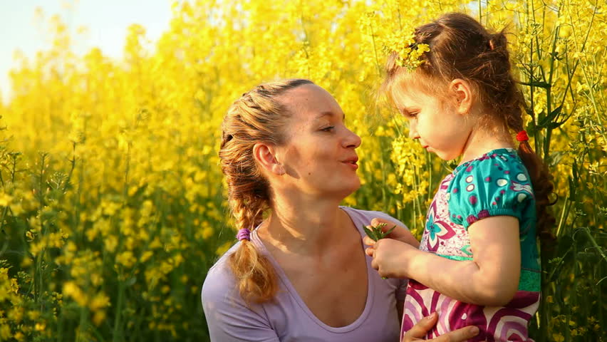 Mom and daughter in a field of flowers - HD stock footage clip