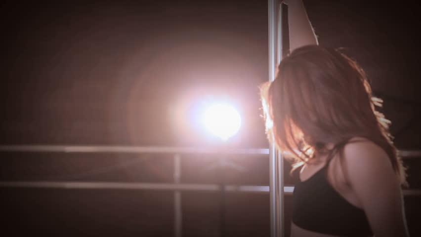 Beautiful woman dancing in strip club